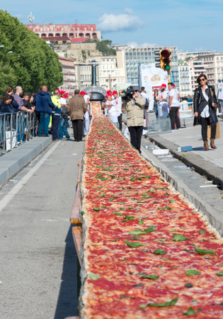 world record: NAPLES, ITALY- MAY 18: 250 pizza chefs from around the world in Naples beat the Guinness world record for long pizza margherita circa 2 Km on  may 18, 2016 in Naples Editorial