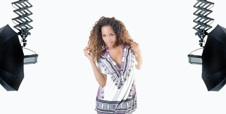 ethnic dress: Brazilian woman with curly hair and ethnic dress in studio with flash Stock Photo