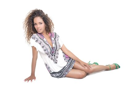 ethnic dress: Brazilian woman with curly hair and ethnic dress on white
