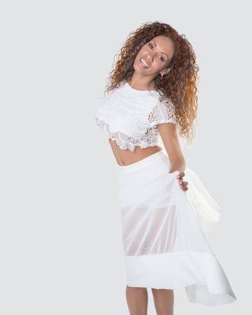 Brazilian smiling woman with curly hair on white background