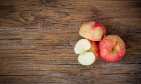 stark: red natural apples  sliced  on wooden table