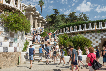 undefined: BARCELONA, SPAIN- AUGUST 4: Undefined people at  Parc Guell international attraction made by Antoni Gaudì on  august 4, 2016 in Barcelona