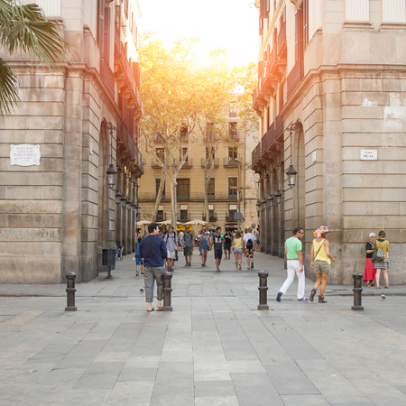 undefined: BARCELONA, SPAIN- AUGUST 3: undefined people at sunset in Placa Real (Royal Square)  on  august 3, 2016 in Barcelona Editorial