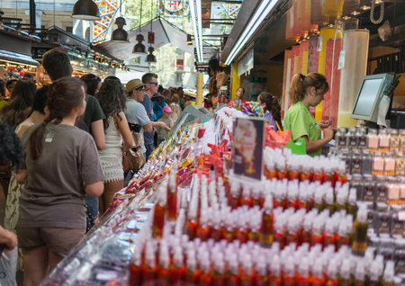 boqueria: BARCELONA, SPAIN- AUGUST 6:undefined people in the ancient and famous Boqueria market, where you will find any grocery on august 6, 2016 in Barcelona - Spain