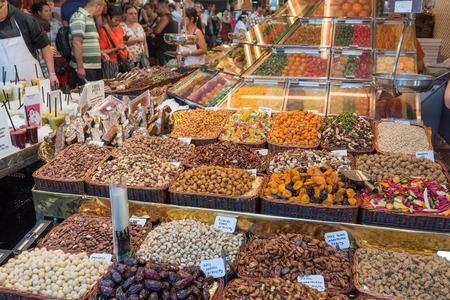 boqueria: BARCELONA, SPAIN- AUGUST 6: undefined people in the ancient and famous Boqueria market, where you will find any grocery on august 6, 2016 in Barcelona - Spain