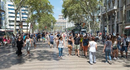 6 people: BARCELONA, SPAIN- AUGUST 6: people walk on the rambla. It is a boulevard in one kilometer long and four hundred meters that connects Catalonia Square with the port on august 6, 2016 in Barcelona - Spain Editorial