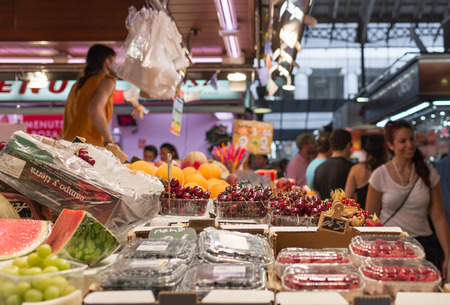 undefined: BARCELONA, SPAIN- AUGUST 6: undefined people in the ancient and famous Boqueria market, where you will find any grocery on august 6, 2016 in Barcelona - Spain