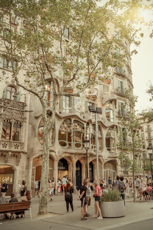 parc: BARCELONA, SPAIN- AUGUST 8: People in Passeig de Gracia  seat Casa Batllo made  by Antoni Gaudi in 1877 and on  august 8, 2016 in Barcelona - Spain