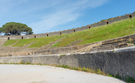 erupting: POMPEII, ITALY- NOVEMBER 13: Pompeii was declared in 1997 by UNESCO World Heritage Site with about 3 million visitors last year. Visible Architecture amphitheater  on november 13, 2016 in Pompeii - Italy