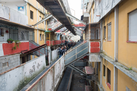 delinquency: Naples-Italy-December 19, 2016: The president of the Chamber Laura Boldrini visit Scampia district and meet its people with the mayor De Magistris. People waiting. Editorial
