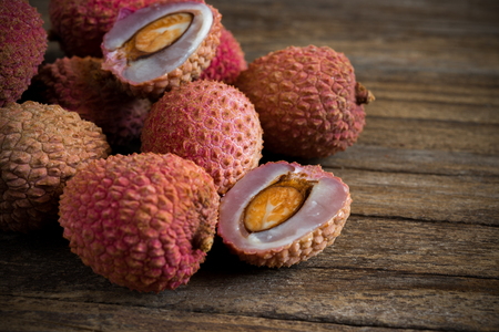fresh litchis on old wooden table Stock Photo
