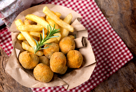 fried stuffed olives with chips and rosemary Banco de Imagens