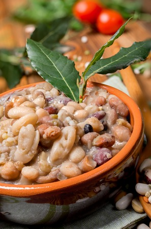 garbanzos: Vegetable soup with cereals and legumes with beans, chickpeas, spelled, barley, broad beans, lentils and laurel