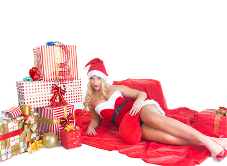 beautiful blond girl with blue eyes dressed as Santa Claus.