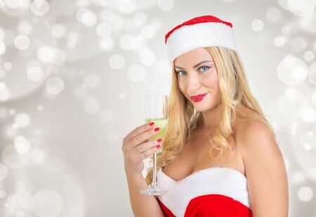 candle: beautiful blond girl with blue eyes dressed as Santa Claus.