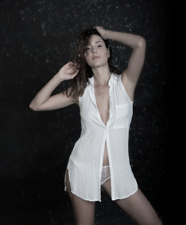 cute girl in nightgown on dark background Banco de Imagens