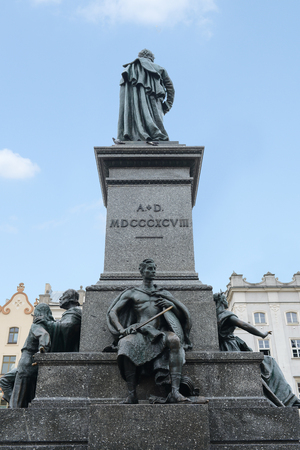 Krakow, Poland - August 4 ,2017:Adam Mickiewicz Monument  is one of the best known bronze monuments and a favourite meeting place at the Main Market Square in the Old Town (Stare Miasto) Редакционное
