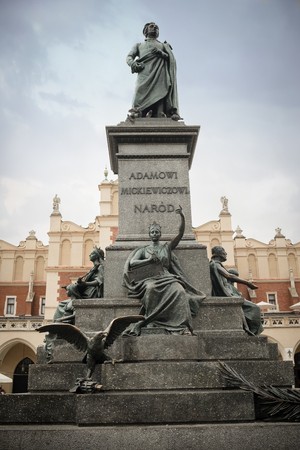Krakow, Poland - August 4 ,2017:Adam Mickiewicz -Polish romantic poet- Monument  is one of the best known bronze monuments and a favourite meeting place at the Main Market Square- Редакционное