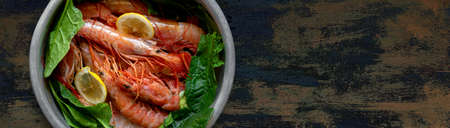 banner raw fresh shrimps and spinach in aluminum plate