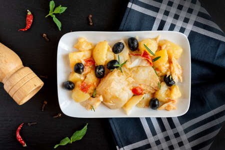 top view of Baked Codfish baccala Recipe with Potatoes and Olives