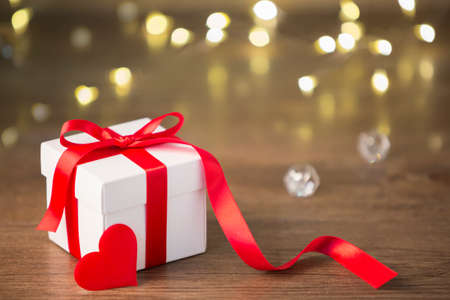 Red gifts tied with a white satin ribbon bow. Stock Photo