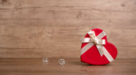 Gift box on the wooden background. Valentines Day gift. Red box