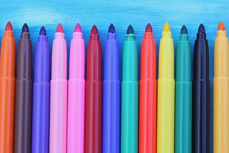 creative: Multicolored maxi Felt-Tip pens on blue background Stock Photo