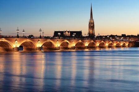 pierre: View of Pont de Pierre bridge and  Saint Michael, Bordeaux, France