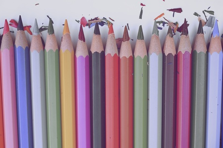 artwork: Colorful pencils and colorful wood shavings on white background
