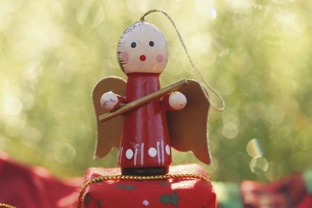 shiny: Christmas angel for hanging on Christmas tree with bokeh background