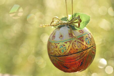 shiny: Christmas ball for hanging on Christmas tree with bokeh background