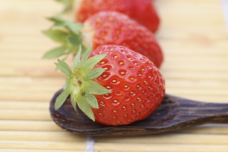 closeup: Closeup of strawberries on wooden spoon