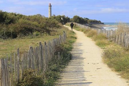 fence: View of old Phare des Baleines lighthouse ile de Rez, France