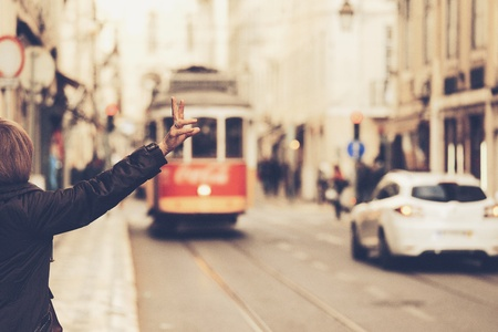 style: A traveler  calling one of the old tram in the center of Lisbon, Portugal in vintage style Stock Photo