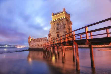 architecture: Belem Tower designed by architecture Francisco de Arruda at twilight with river Tagus Estuary on the back Stock Photo