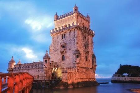 back: Belem Tower designed by architecture Francisco de Arruda at twilight with river Tagus Estuary on the back Stock Photo