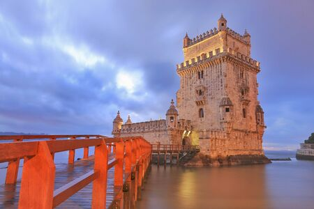 heritage protection: Belem Tower designed by architecture Francisco de Arruda at twilight with river Tagus Estuary on the back Stock Photo