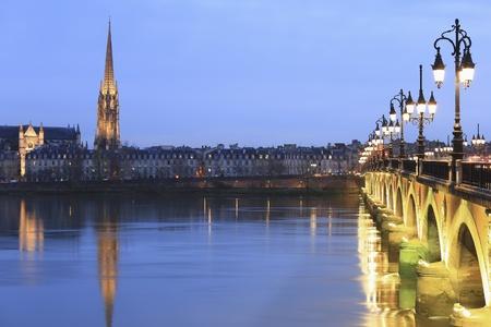 pierre: Twilight at Pont de Pierre bridge and St. Michael church, Bordeaux, France