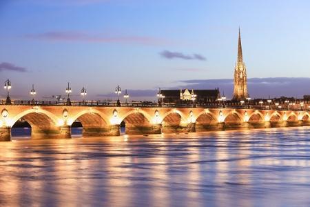 tramway: Twilight at Pont de Pierre and tramway rail on the bridge, Bordeaux, France