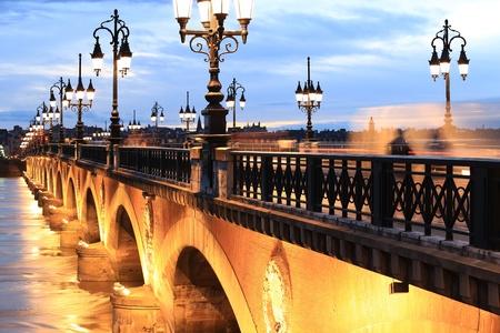 pierre: Twilight at Pont de Pierre bridge, Bordeaux, France Stock Photo