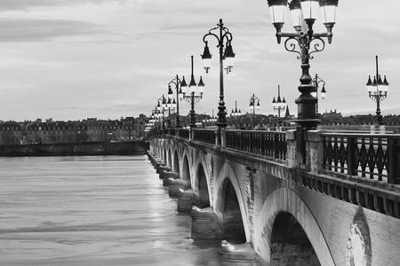 white: Twilight at Pont de Pierre bridge in black and white, Bordeaux, France