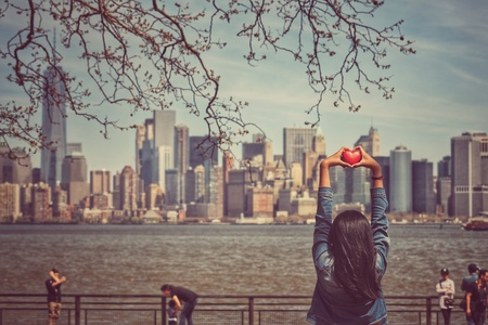style: Love concept, hands holding heart shape on Manhattan skyline background in vintage style Stock Photo