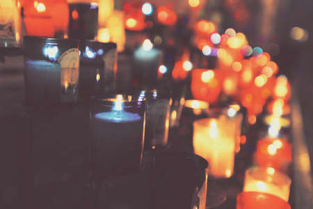 abstract: Colorful abstract candles light background in a church, vintage style