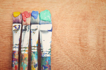 creative: Closeup of paintbrush on wooden background