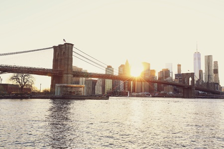 style: Brooklyn bridge and Manhattan skyline at sunset in vintage style Stock Photo