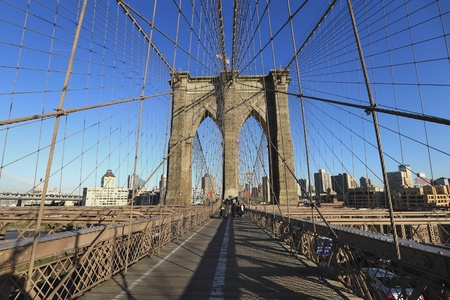 urban: Brooklyn bridge and Manhattan skyline with blue sky Stock Photo