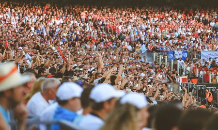 sporting event: Blurred crowd of spectators on stadium at a sporting event Editorial