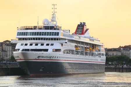 sight seeing: FRANCE, BORDEAUX - SEPTEMBER 29, 2016 : famous dutch cruise ship stopping in Bordeaux for passengers to enjoy the sight seeing of the Garonne river