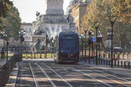 tramway: BORDEAUX, FRANCE - SEPTEMBER 30, 2016 : City street scene with tramway in Bordeaux, France