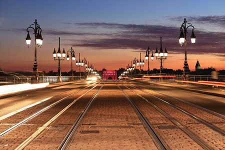 tramway: Pont de Pierre and tramway rail on the bridge sunset, Bordeaux, France